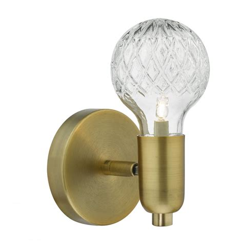 soft aged brass single wall light with decorative cut