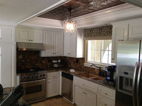 If you are updating your kitchen, you may choose to update an old fluorescent kitchen light that looks dated. tin inlay for florescent lighting box Vrieling Woodworks-Kitchen cabinet refacing   Inexpensive ...