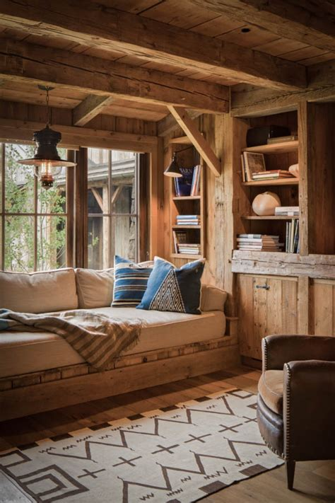 beautiful log home interiors built in day bed bookshelves in a window nook timber fram style rustic and beautiful