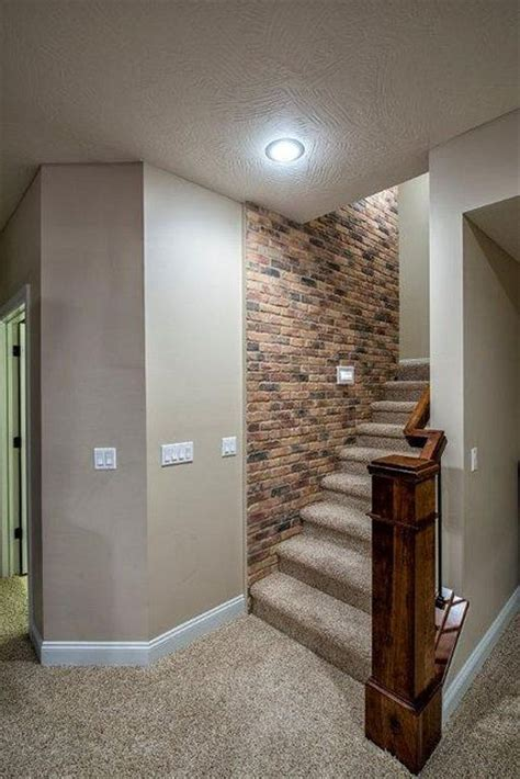 basement stairs leading to floor brick wall