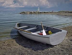 Row Boat On The Beach In Toronto Photograph by Randall Nyhof