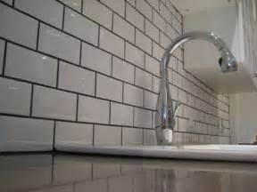 kitchen backsplash subway tile with dark grey grout this