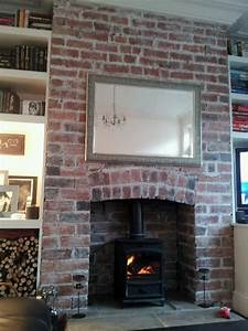 My red brick fireplace transformed santa39s grand for Open brick fireplace ideas