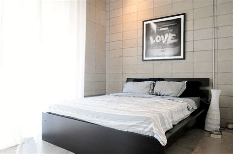 White bed linen black bedframe