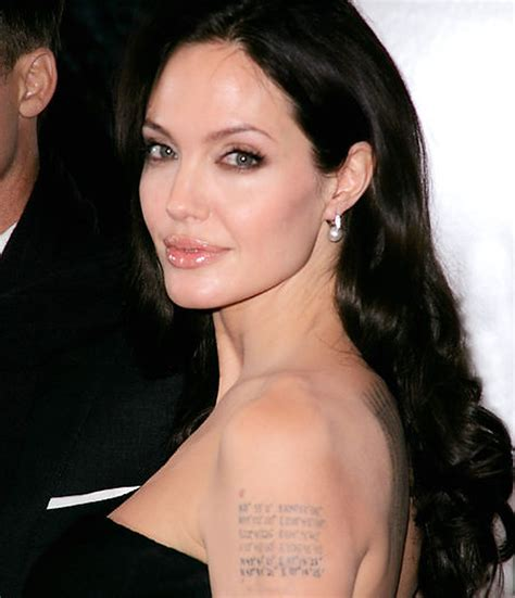 Angelina Jolie unveils new tattoos at 'Changeling ...