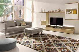 Carpet Designs For Living Room by Cowhide Rug Living Room Images