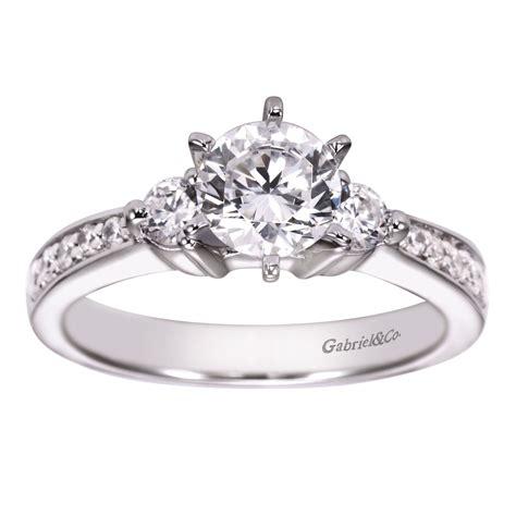 contemporary three stone channel set diamond engagement ring