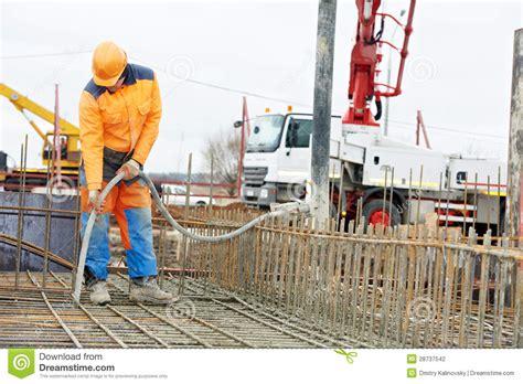 form vibrator concrete builder worker vibrating concrete in form stock photo