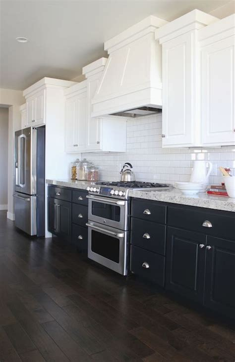 kitchen cabinets white top black bottom the white up top to brighten and the bottom 9177
