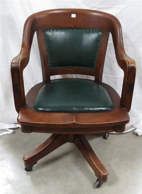 antique wood and leather office chair on wheels
