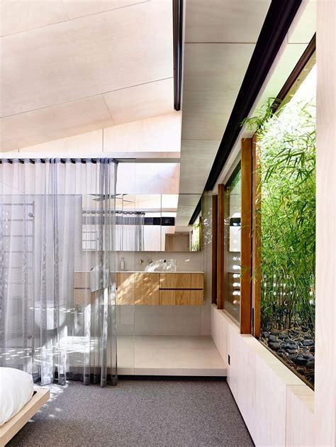light wells  garden features transform urbane aussie home