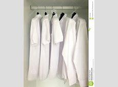 White Shirts Hanging On The Racks Stock Photo Image