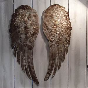 Large metal angel wings wall decor distressed gold ivory