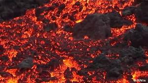 See Molten Lava Crawl Over The Sand