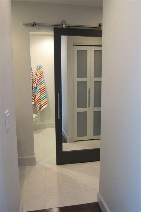 Bathroom Door Mirrors by Sliding Bathroom Door With Mirror For The Home