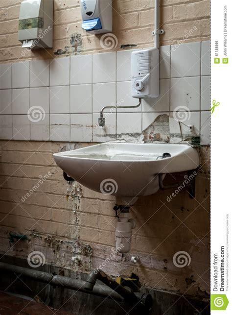bathroom sink broken and vandalized industrial bathroom sink stock photo Industrial