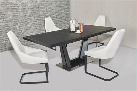 matt black extending glass dining table and 8 white chairs