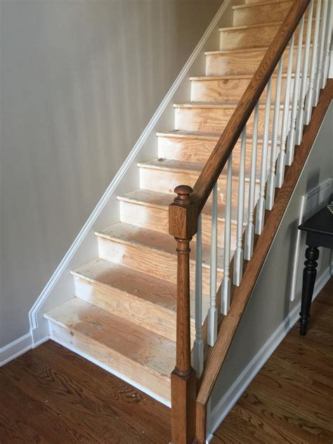 black staircase treads  railing  cabinet girls