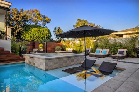 pool  patio hot tub  submerged lounge chairs hgtv
