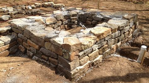 how to build a base for a granite top a cob house stone foundation tips for finding stones