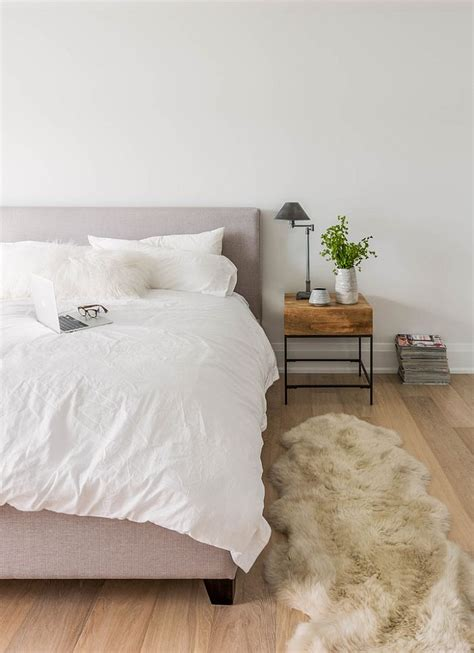 small bedroom rugs 36 relaxing and chic scandinavian bedroom designs 13266 | Bedside table and plush rug bring warmth to the cool bedroom
