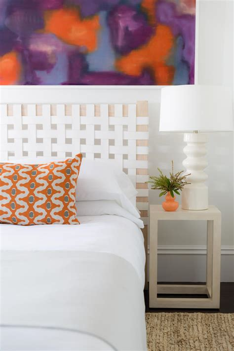 white transitional hotel room  colorful artwork hgtv
