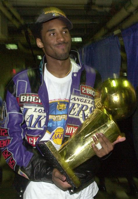 Kobe bryant's nba life, in photo form. Kobe Countdown: The History (Part 2): Three titles for Kobe-Shaq-Phil trio - Orange County Register
