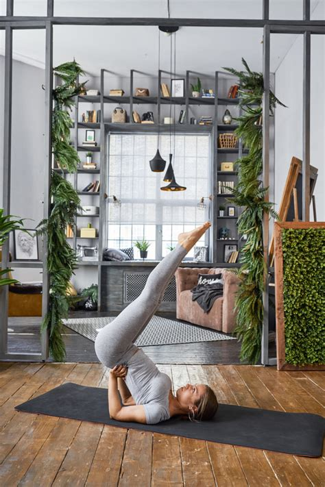 Woman Practicing Yoga In The Living Room Stock Photo 31. Basement Laundry Sink. Basement Pine. Build Basement Storage Shelves. Finished Basement Gallery. Cost Of Renovating Basement. Musty Basement Smell. Basement Finishing Ideas Cheap. Best Sound Insulation For Basement Ceiling