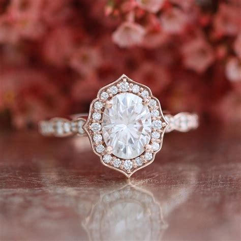 Oval Cut Forever One Moissanite Vintage Floral Engagement Ring. Calcite Rings. Lab Grown White Engagement Rings. Alternative Rings. 30 Year Wedding Rings. Justice League Rings. 2.15 Carat Engagement Rings. Gold Malaysia Wedding Rings. Champagne Diamond Engagement Rings