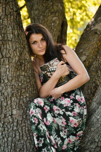 Attractive Seductive Brunette Girl With Languishing Look In Autumn Park Relax On The Wooden