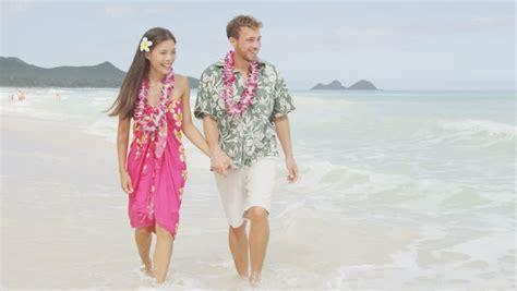 Happy Hawaii Beach Holiday Couple In Aloha Shirt And Dress