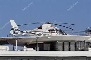 Hélicoptère De Luxe : h licopt re dans un yacht de luxe photographie agafapaperiapunta 108811876 ~ Medecine-chirurgie-esthetiques.com Avis de Voitures