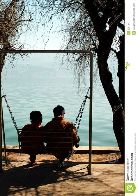 couples swing sitting on swing royalty free stock photography