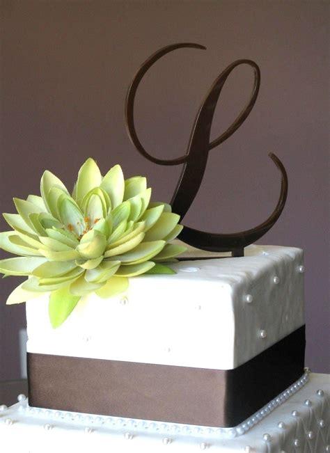 classy style  monogram toppers   wedding cake  wedding ideas vendors