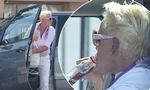 Brigitte Nielsen sips Popov vodka behind wheel of her ...