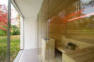 Bespoke sauna with glass fronting, looking out onto garden