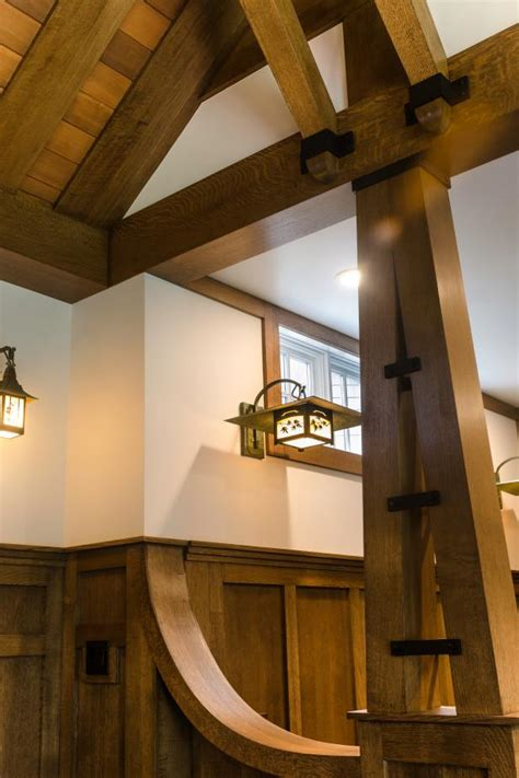 craftsman home  exposed beam ceilings  sconce