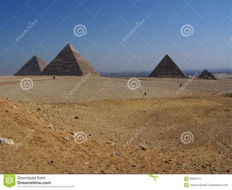 Desert Landscape Giza Pyramids With Cairo City In Distanc