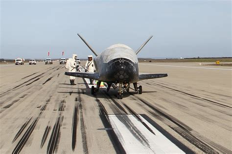 X-37B military space plane lands after 22-month secret ...