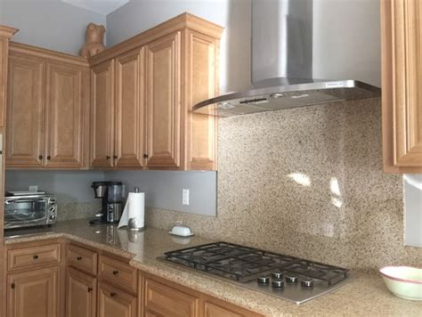 Does A White And Grey Quartz Countertop Match Maple Cabinets?