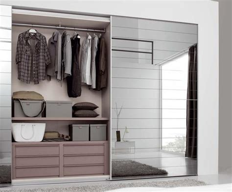 sliding closet doors to hide storage spaces and create