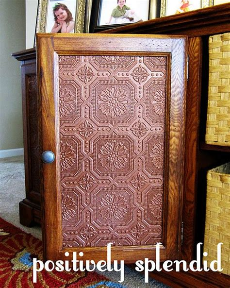 Wallpaper For Cupboard Doors by Faux Tin Panels To Replace Glass Cabinet Doors May