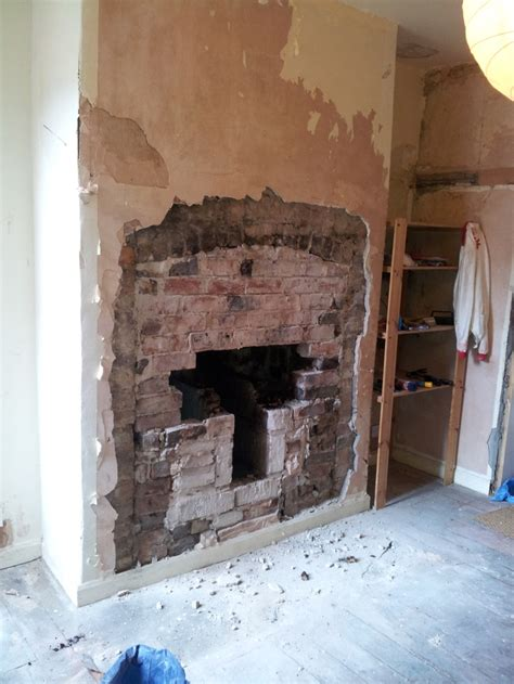 pin    expose  brick chimney breast  cement hearth