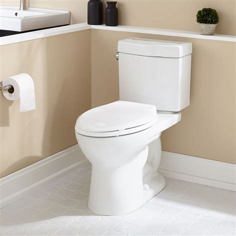 luther elongated  piece toilet  compliant bathroom