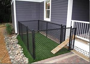 a small very small backyard dog run right off the porch With small dog kennel and run