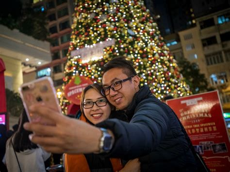 christmas china celebrations ban shame chinese banned communists selfie officials communist local hong party kong couple celebrating front getty members