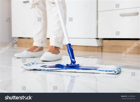 cleaning kitchen floor cleaning service mopping floor kitchen stock photo 2235