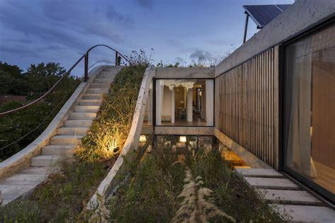 Eco-friendly House Built Around A Vertical Garden