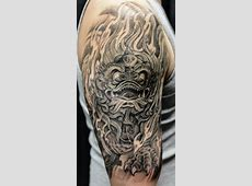 Wonderful Roaring Foo Dog Tattoo On Half Sleeve