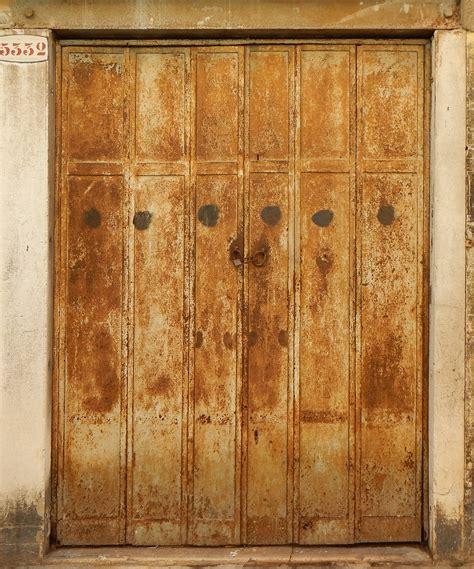 rusted door metal rusted door hinge attached  screws